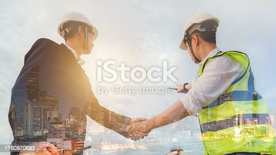 1071990712istockphoto Double exposure of engineers cooperate with businessmen to agree to work together on cityscape. 1160970883