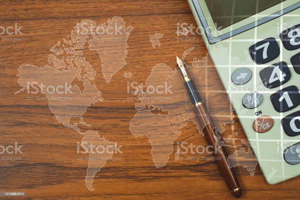 Double exposure of fountain pen or ink pen with calculator on table double exposure of fountain pen or ink pen with calculator on table with world map gumiabroncs Images