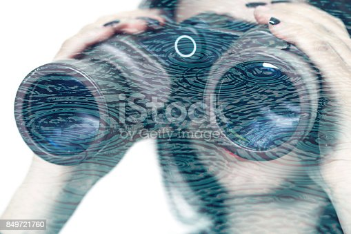 istock Double exposure of girl looking through binoculars and rain circles 849721760