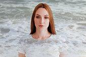 Double exposure of girl profile portrait and sea foam texture