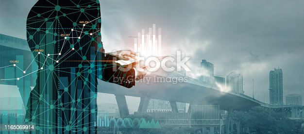 865596974istockphoto Double exposure of graph chart and network connection on businessman using tablet analyzing sales data and economic growth on citiy background. Business and digital technology. 1165069914