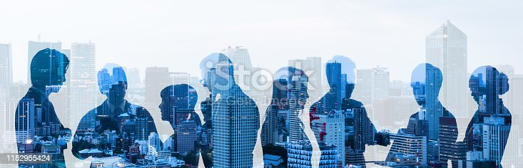 istock Double exposure of group of businessperson and cityscape. 1152955424
