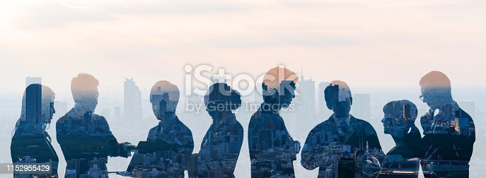 istock Double exposure of group of businessperson and cityscape. 1152955429