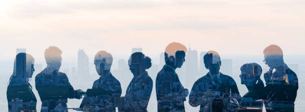 Double exposure of group of businessperson and cityscape. stock photo
