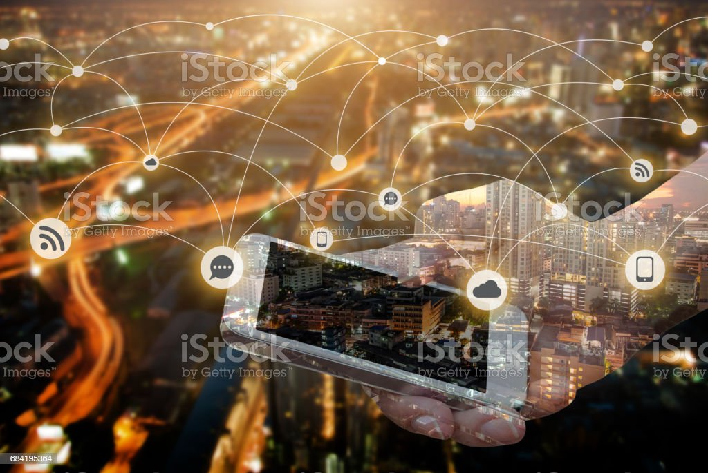 Double exposure of hand hold smartphone over night city royalty-free stock photo