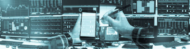 double exposure of hand holding blank smartphone with stock market quotes and chart in monitor computer room with business office equipments .business and money concept, panorama. - laptop digital composite stock pictures, royalty-free photos & images