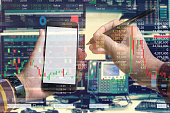 istock Double exposure of hand of business man using smartphone with stock trading room and stock trading chart background for investment business concept. 1153053010