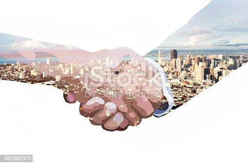 istock double exposure of handshake and skyline 532862370