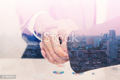istock Double exposure of handshake with citi background 615839434