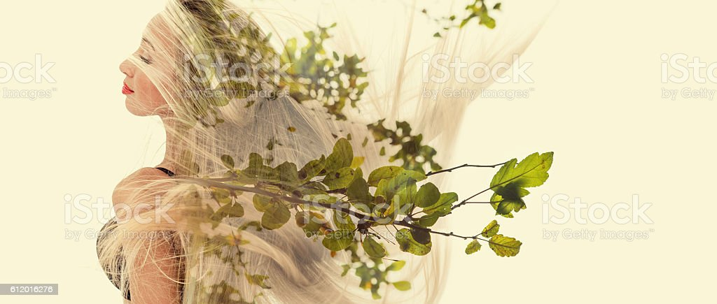Double exposure of happy girl dancing and green leaves stock photo