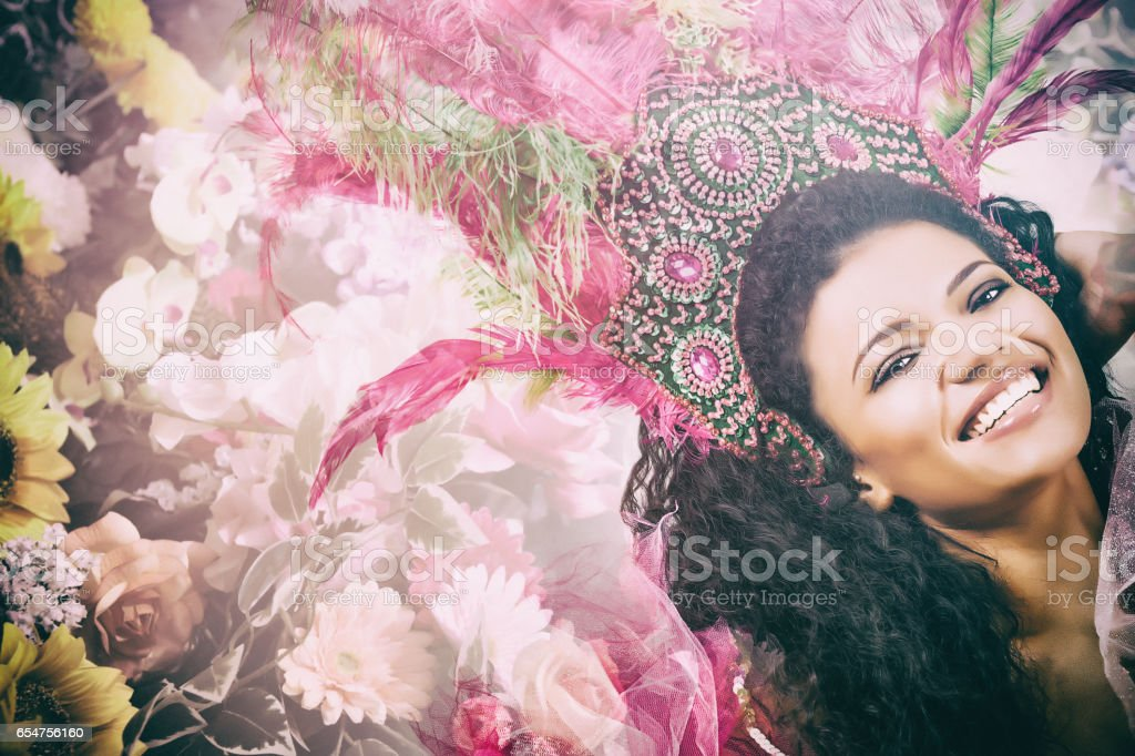 Double exposure of happy samba dancer portrait and colorful flowers stock photo
