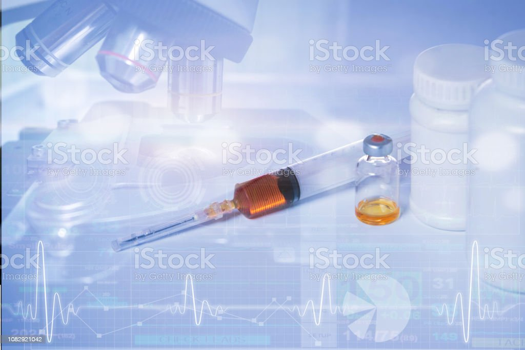 double exposure of injection medicine and microscope stock photo