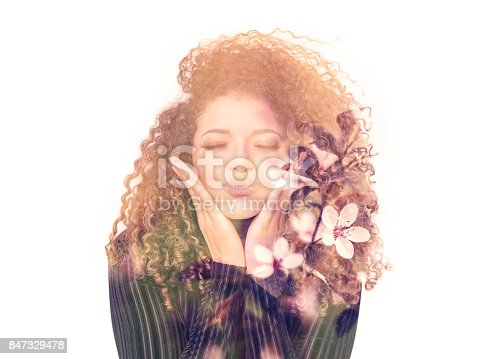 istock Double exposure of lovely woman giving kiss and beautiful cherry blossoms 847329478