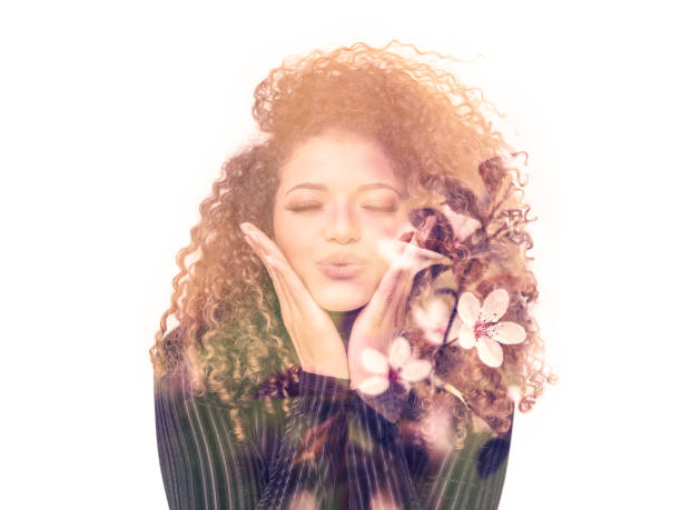 double exposure of lovely woman giving kiss and beautiful cherry blossoms - cherry blossoms imagens e fotografias de stock
