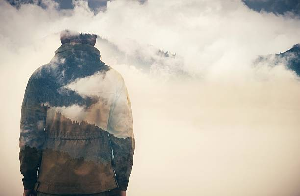 double exposure of man and cloudy mountains - spirituality stock photos and pictures