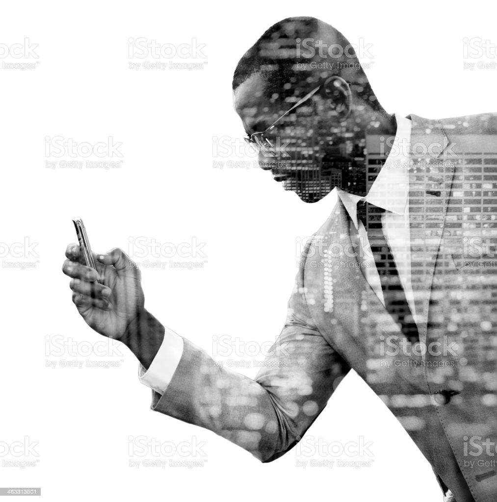 Double exposure of man using phone stock photo