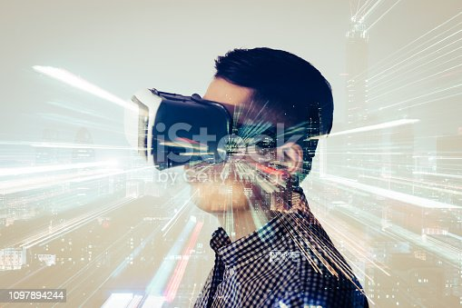 istock Double Exposure of Man Wearing Virtual Reality Headset and Smart City 1097894244