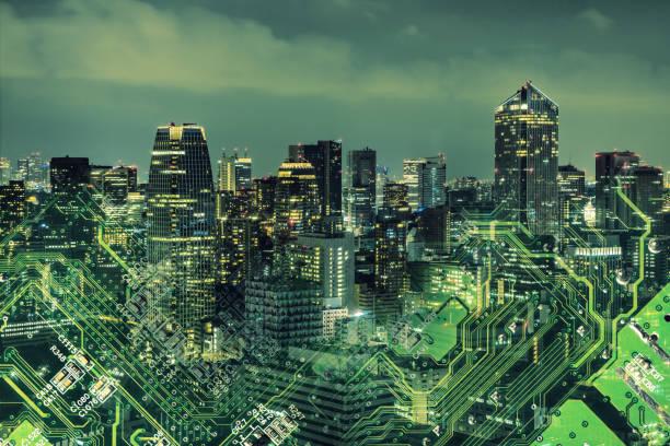 double exposure of modern cityscape and electric circuit. - rete elettrica foto e immagini stock