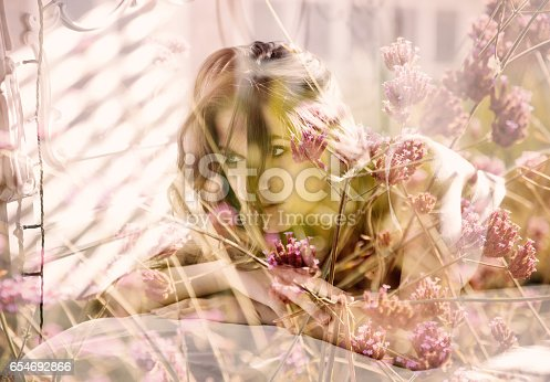 istock Double exposure of pretty woman morning portrait and pink flowers 654692866