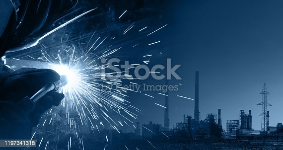 1091790362 istock photo Double exposure of production and welding process. Modern technologies for the comfortable life of mankind and the industrial revolution 1197341318