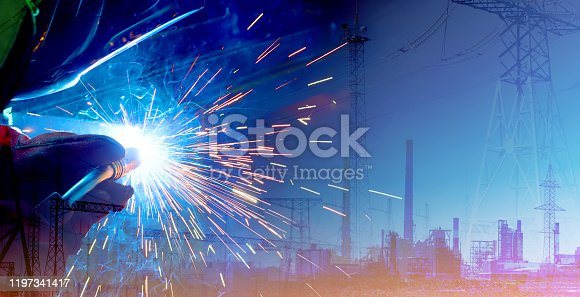 1091790362 istock photo Double exposure of production and welding process. Modern technologies for the comfortable life of mankind and the industrial revolution 1197341417