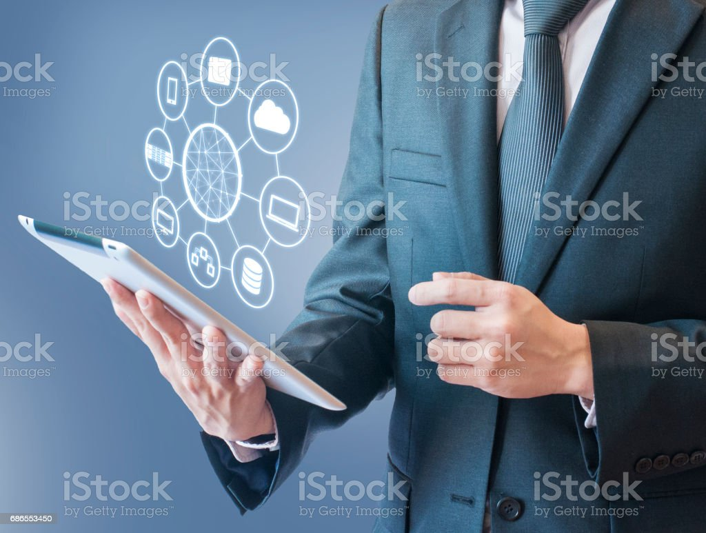Double exposure of professional businessman connecting network and devices on hand in Cloud technology, communication and business concept royalty free stockfoto