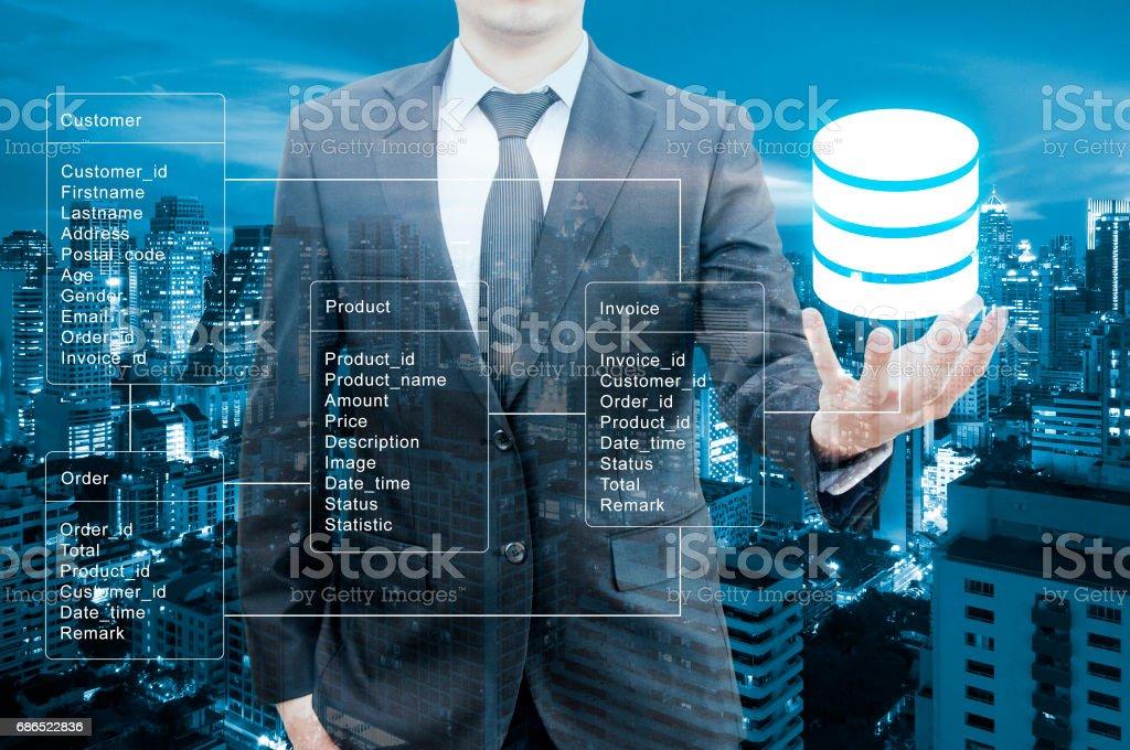 Double Exposure Of Professional Businessman Hold Database