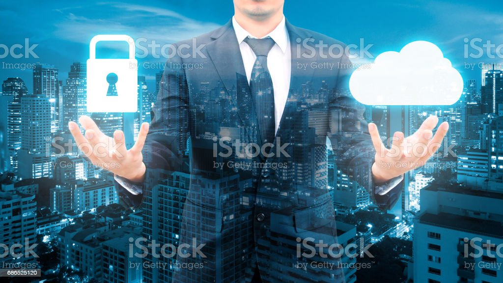 Double exposure of professional businessman security protection and cloud network connection technology with cityscape in communication , business and security technology concept royalty-free stock photo