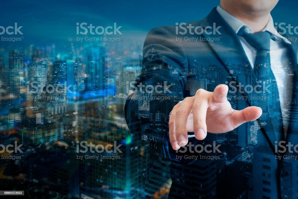 Double exposure of professional businessman touch digital screen with cityscape of business in Technology and business concept foto stock royalty-free