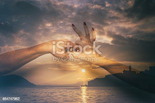 istock Double exposure of sex gesture and beautiful lake at sunset 654747952