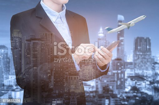 istock Double exposure of Smart Business women use smartphone for booking air ticket with smart city view. 673833224