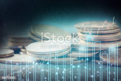 istock Double exposure of stock and profit graph on rows of coins for finance and banking concept. 692725002