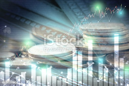 istock Double exposure of stock and profit graph on rows of coins for finance and banking concept. 692725160