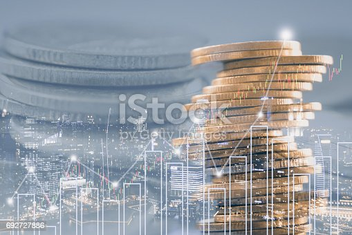 istock Double exposure of stock and profit graph on rows of coins for finance and banking concept. 692727886
