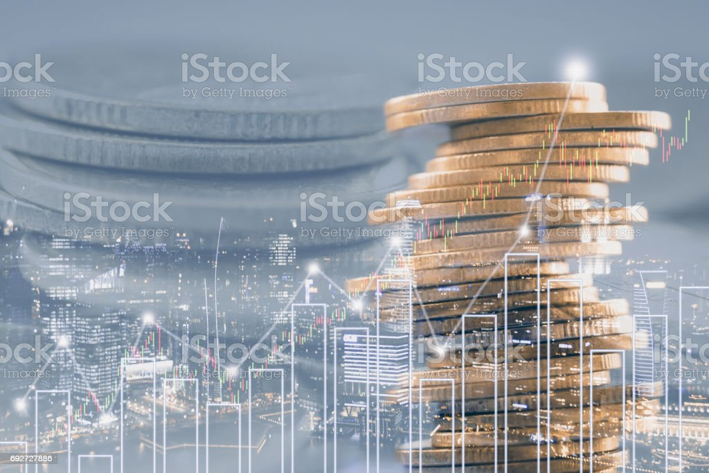Double exposure of stock and profit graph on rows of coins for finance and banking concept. stock photo