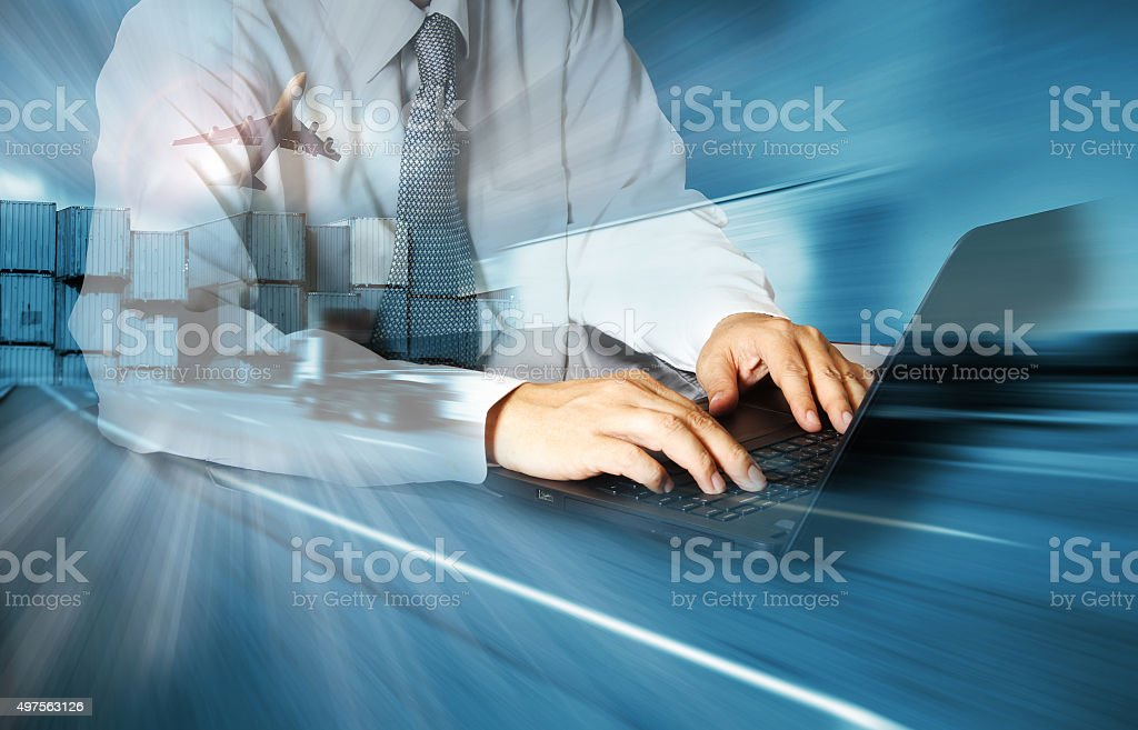 Double exposure of success businessman using computer stock photo