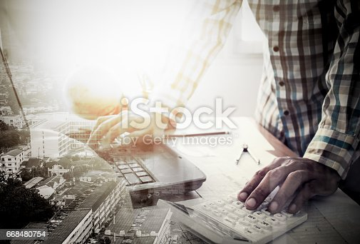 istock Double exposure of success land developer working in office 668480754