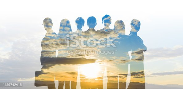 Double exposure of sunshine and group of people.