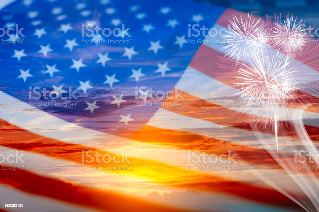 Double exposure of  usa flag on sunset sky and firework stock photo