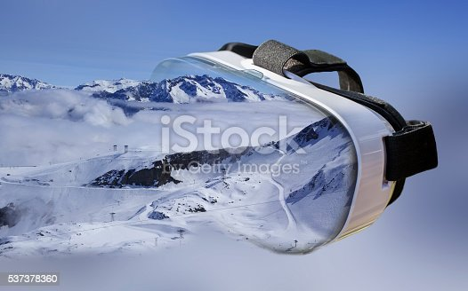 istock Double exposure of VR headset skiing center 537378360