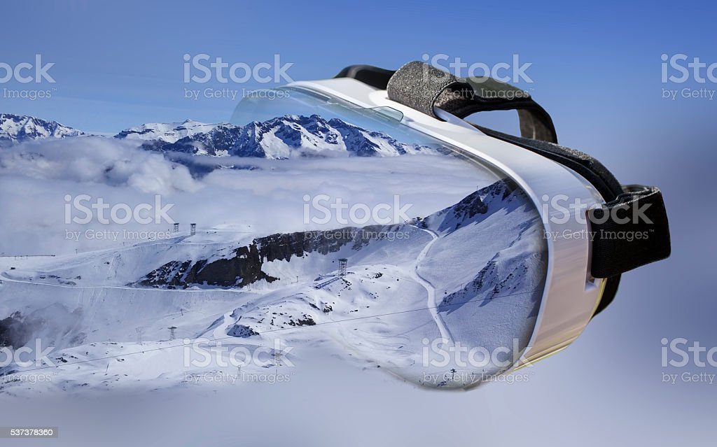 Double exposure of VR headset skiing center stock photo