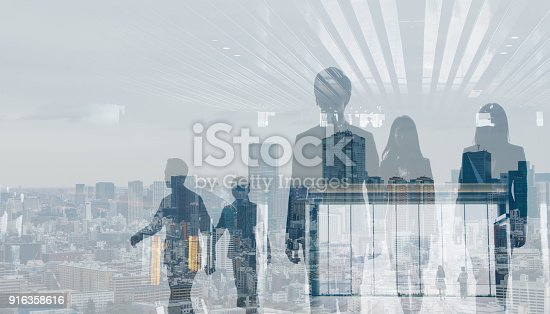 1079450712 istock photo Double exposure of walking business persons and modern cityscape. 916358616