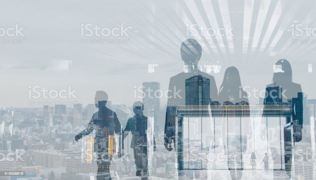 Double exposure of walking business persons and modern cityscape. stock photo