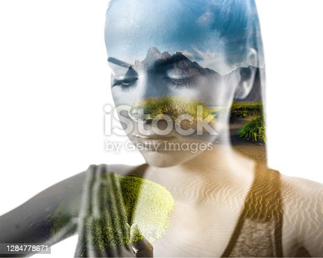 Double exposure of young woman doing yoga and rippled sandy desert