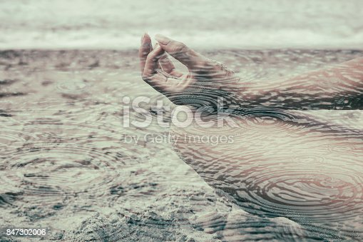 istock Double exposure of woman detail portrait meditating and rain circles 847302006