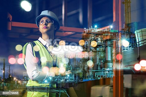 istock double exposure of woman labor and factory exterior. industrial technology concept. 858529688