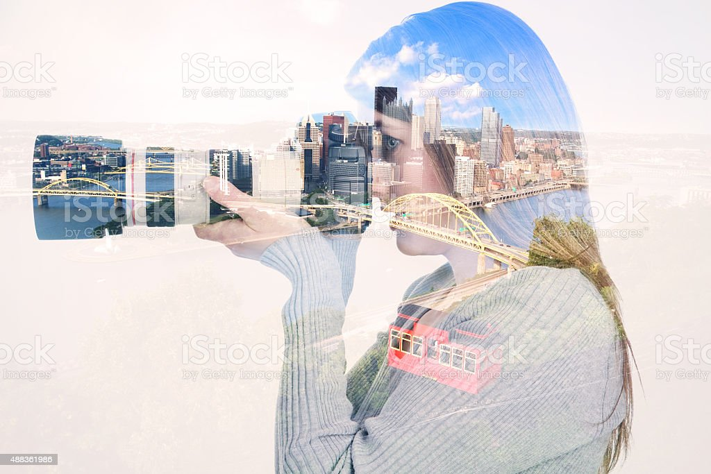 Double Exposure Of Woman With Camera Photographing Pittsburgh stock photo