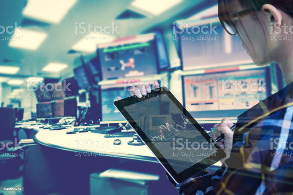 Double exposure of  women Engineer in hipster shirt  working with tablet in control room of oil and gas platform or plant industrial for monitor process, business and industry concept stock photo