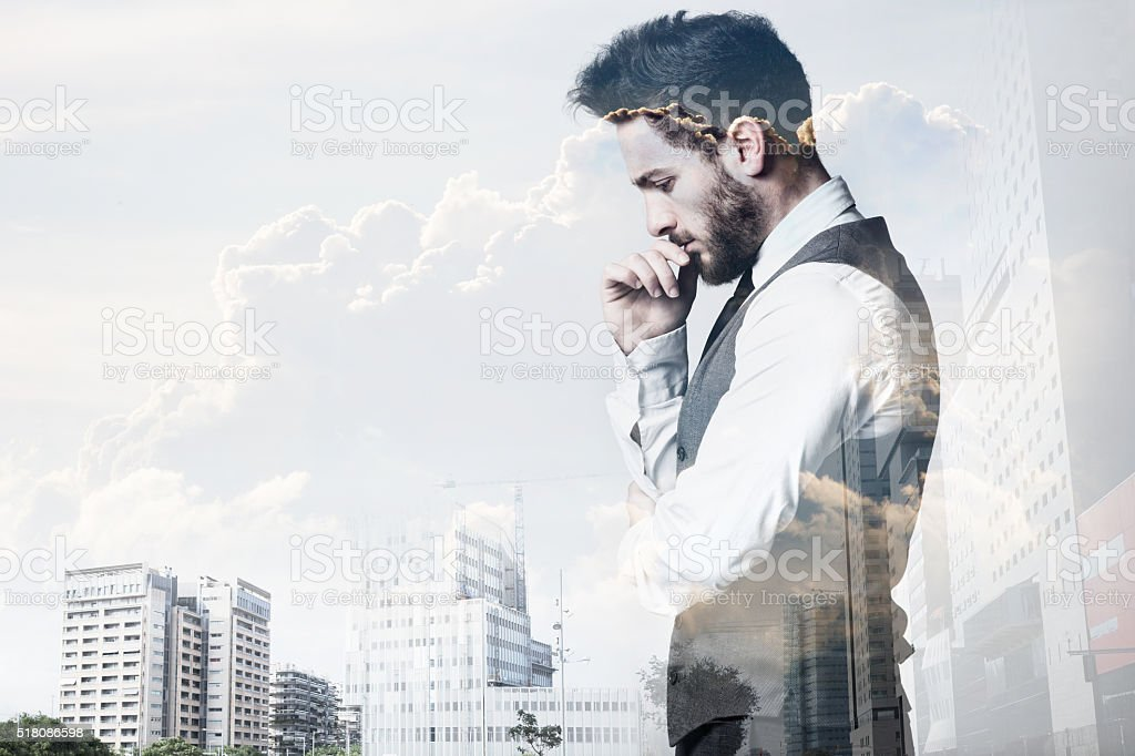 Double exposure of young businessman and city. stock photo