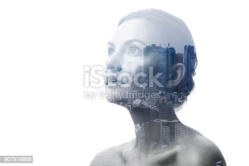 916376282 istock photo Double exposure of young woman and building exterior. 907916868